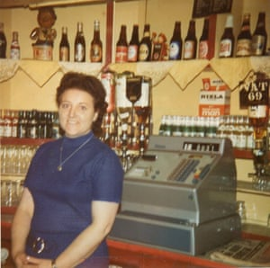 Woman smiles at the camera from the bar of the Reno