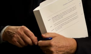 EU chief Brexit negotiator, Michel Barnier, holds the draft withdrawal agreement on Wednesday