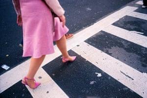 Woman in bubblegum pink suit in Manhattan