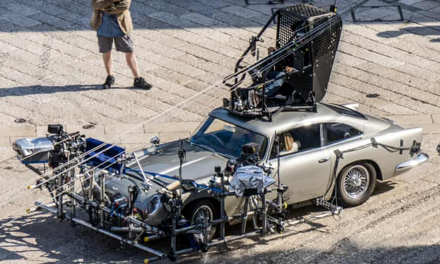 Daniel Craig is partially seen sitting inside one of the Aston Martin DB5s used on the set of No Time to Die in Matera, southern Italy.