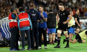 Sam Cane looks on as officials and doctors discuss whether he was permitted to play on