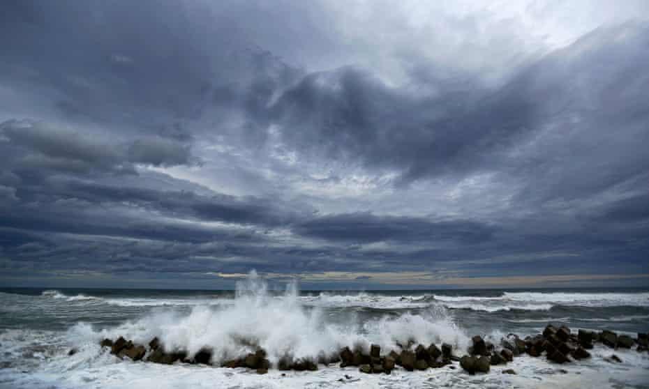 Waves break into the anti-tsunami barriers