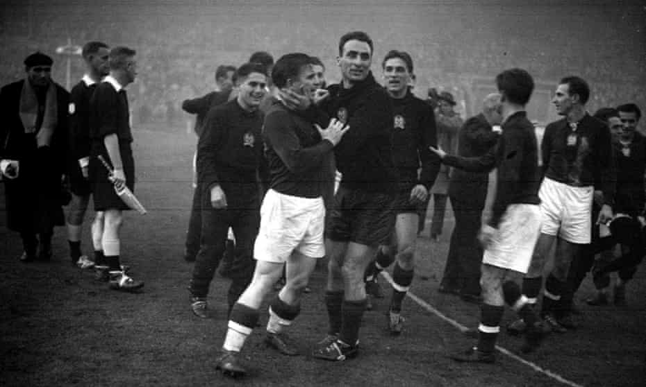 Goalkeeper Sandor Geller (right) embraces his captain, Ferenc Puskás, after Hungary had defeated England 6-3 at Wembley in 1953, part of 30-game unbeaten streak that would end in the 1954 World Cup final.