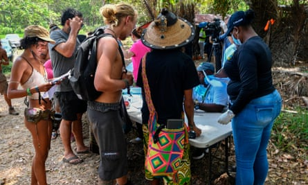 Local health workers check attendees of the Tribal Gathering festival rock in Cuango.