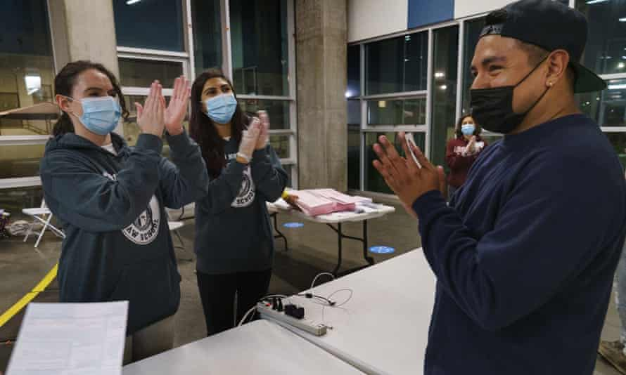 Loyola Law School students congratulate first-time voter Hector Escobar Solis, in Los Angeles, on Tuesday.