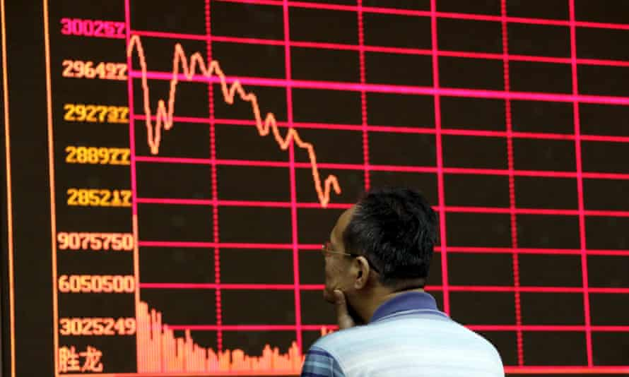 An investor looks at an electronic board showing stock information of Shanghai Stock Exchange Composite Index in Beijing. Stocks were volatile on Wednesday across Asia.