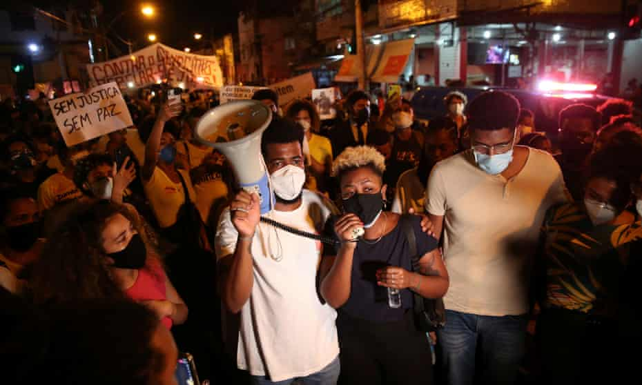 Demonstrators attend a protest against the death of Kathlen Romeu, in Rio de Janeiro, Brazil, on Wednesday.