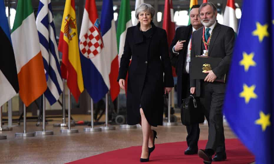 Theresa May and UK permanent representative to the EU Tim Barrow arrive at the European union summit in Brussels, 14 December 2017.