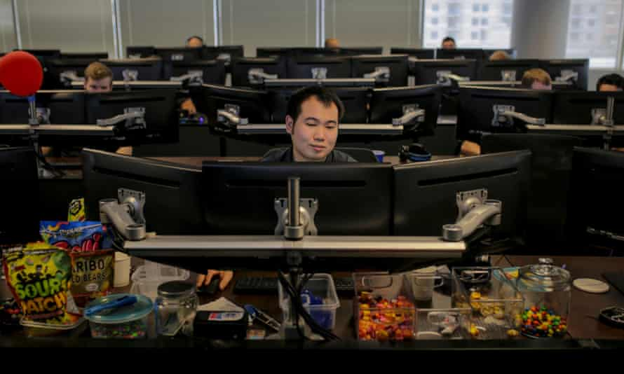 Edwin Keo of Tampa works at his desk at ReliaQuest in Tampa, Fla. on Tuesday, June 20, 2017. He analyzes phishing emails and monitors client environments.