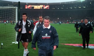 A downhearted Kevin Keegan leaves the field after England lose their last match at the old Wembley Stadium to Germany. It turned out to be his last game in charge as he resigned shortly afterwards.