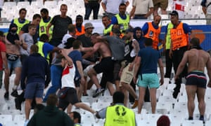 Fans clash after the Euro 2016 match between England and Russia in Marseille.