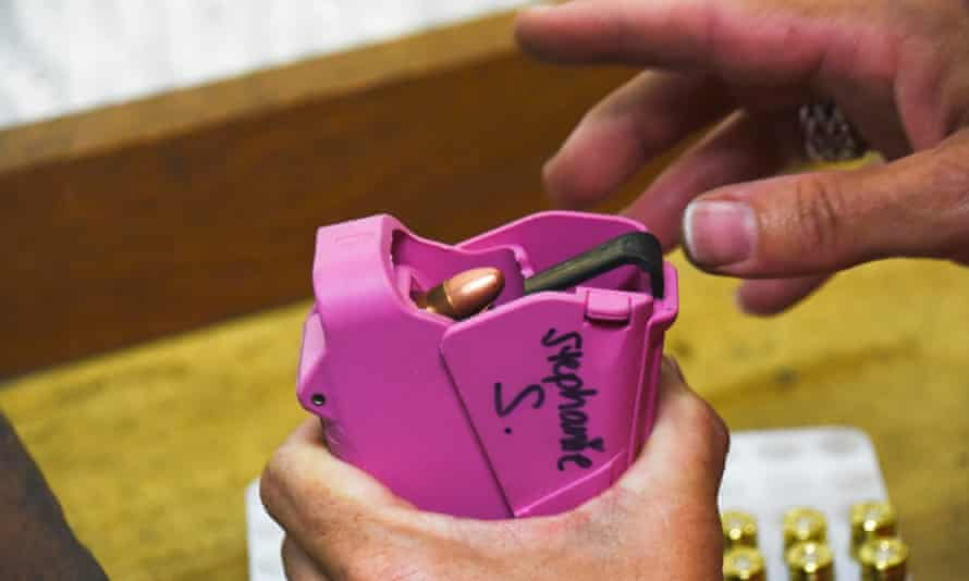 Stephanie Stockman, chapter leader of the Well Armed Woman, uses a speed loader to fill up a clip.
