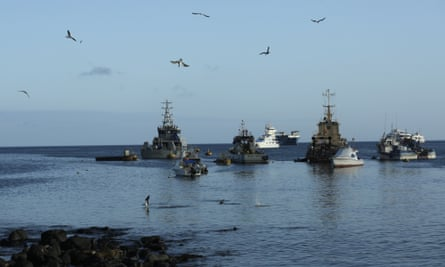 Fishing and tourist boats are anchored in the bay of San Cristobal, Galapagos Islands, Ecuador.