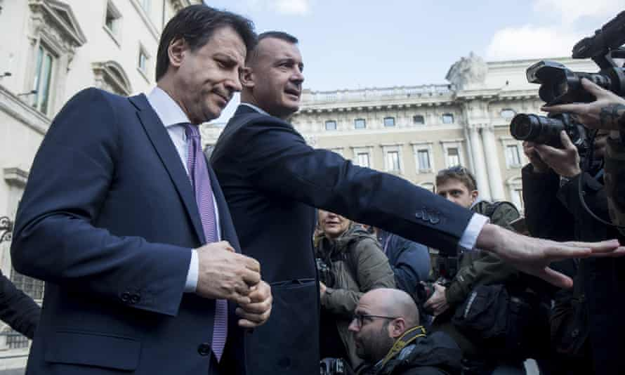 The Italian premier, Giuseppe Conte, speaks to reporters in Rome after the regional elections