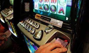 Gambler playing poker machines