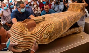 Egyptian minister of tourism and antiquities Khaled Al-Anani, left, opens a sarcophagus excavated earlier this month by the Egyptian archaeological mission working at the Saqqara necropolis.