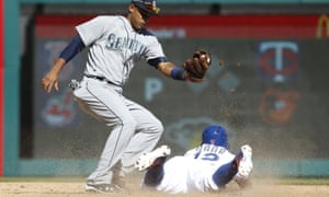 Texas Rangers second baseman Rougned Odor steals second base in the fifth inning against Seattle Mariners shortstop Ketel Marte at Globe Life Park in Arlington.