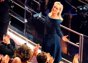 Actress Meryl Streep reacts to spontaneous applause from the audience as she takes her seat