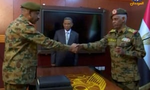 Ahmed Awad Ibn Auf and the Sudanese military's chief of staff, Lt Gen Kamal Abdul Murof Al-mahi after being sworn as leaders of the military transitional council.