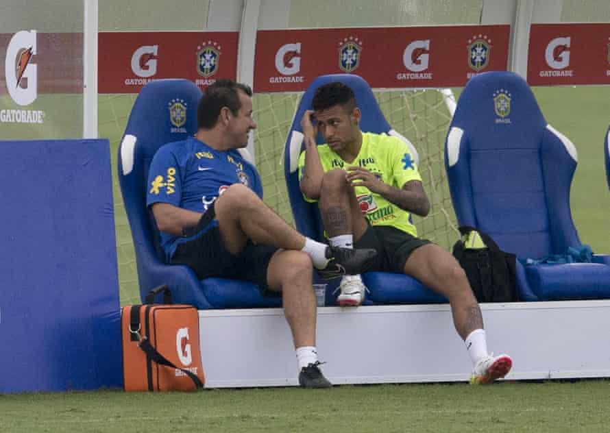 Dunga talks with Neymar after training in Teresopolis.