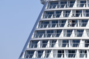 Crew on the balcony of the Celebrity Apex cruise ship, Saint-Nazaire, France, 1 April 2020