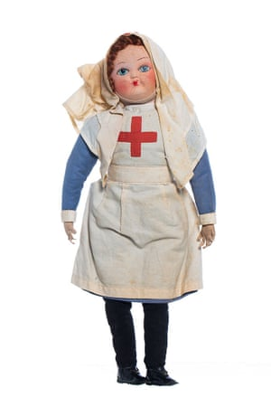 A cloth doll wearing a British Red Cross nurses uniform from the first world war