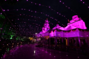 A temple is illuminated with decorative lighting in Bhopal, India