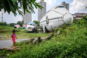 A child plays in Bangkok's 'airplane graveyard', an area of the city that has become a tourist attraction in the Thai capital.