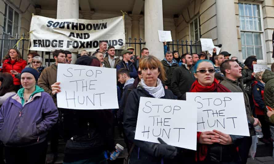 Anti-hunt protesters among the crowds who turned out to see the Southdown and Eridge Hunt on Boxing Day in Lewes