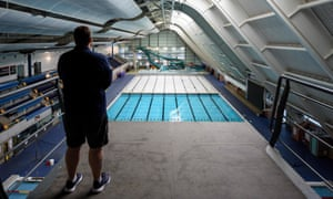 Leisure centre manager Ryan Walker inspects the swimming pool hall of the Manchester Aquatics Centre before reopening.