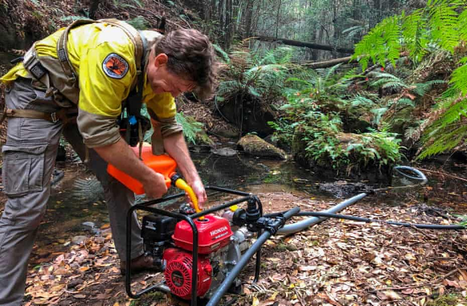 Firefighter operating irrigation machine