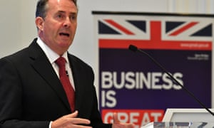 Liam Fox, the trade secretary, with union jack/Business Is Great poster