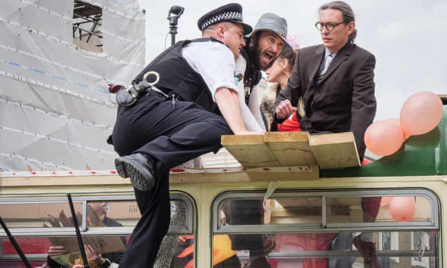 Police wielded batons and against Extinction Rebellion protesters as they battled to gain control of an open-top bus blocking London Bridge