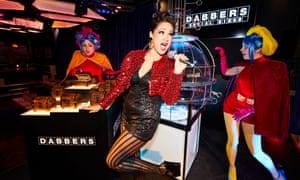 Dabbers Bingo in a nightclub-like black walled basement lit in neon.