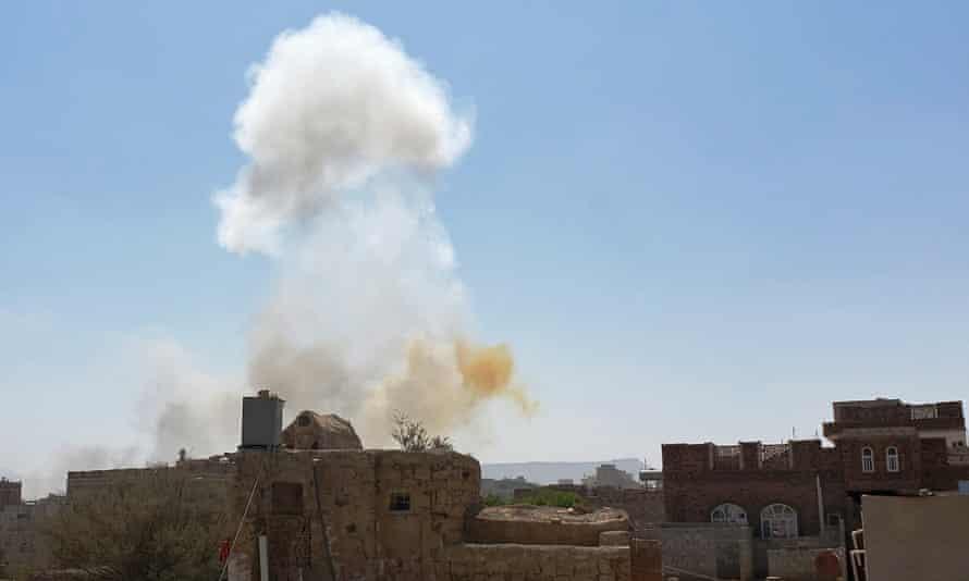 Smoke rises after Saudi-led airstrikes on an army base in Sanaa, Yemen.