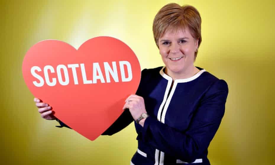nicola sturgeon holding big red cardboard heart with scotland written in it