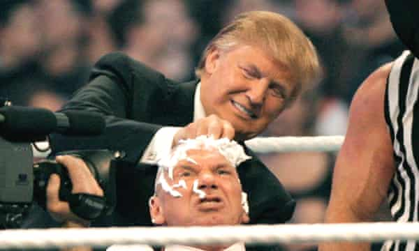 Donald Trump shaves Vince McMahon's head.