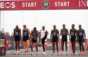 Kipchoge stretches on the start line ahead of historic attempt.
