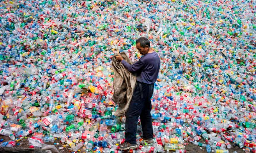A Chinese labourer sorting out plastic bottles  on the outskirt of Beijing