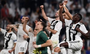 Juventus players celebrate after their win over Napoli.