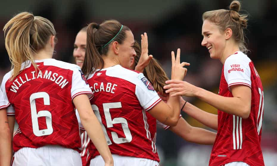 Vivianne Miedema celebrates with her Arsenal teammates after scoring her third and the team's fifth against Spurs