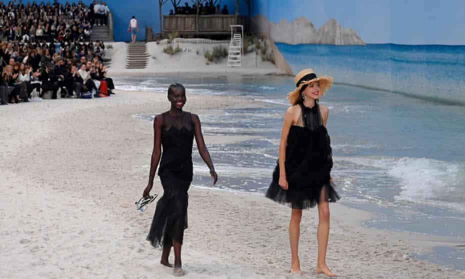 Chanel models stroll on the beach.