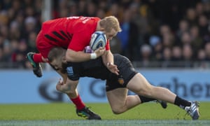 Saracens' Vincent Koch is tackled by Exeter's' Luke Cowan-Dickie.