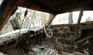 Jumbuck resident Gary Williams inspects his property on O'Reillys Hill Road after fighting flames through the night to save his house