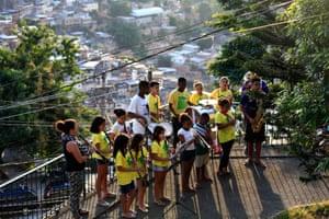 The Favela Brass band rehearse overlooking Pereira da Silva favela