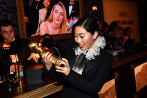 Awkwafina, who won best actress in a motion picture musical or comedy for The Farewell, at the Golden Globes official afterparty