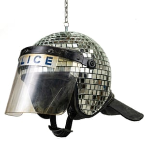 Disco ball made from used police riot helmets