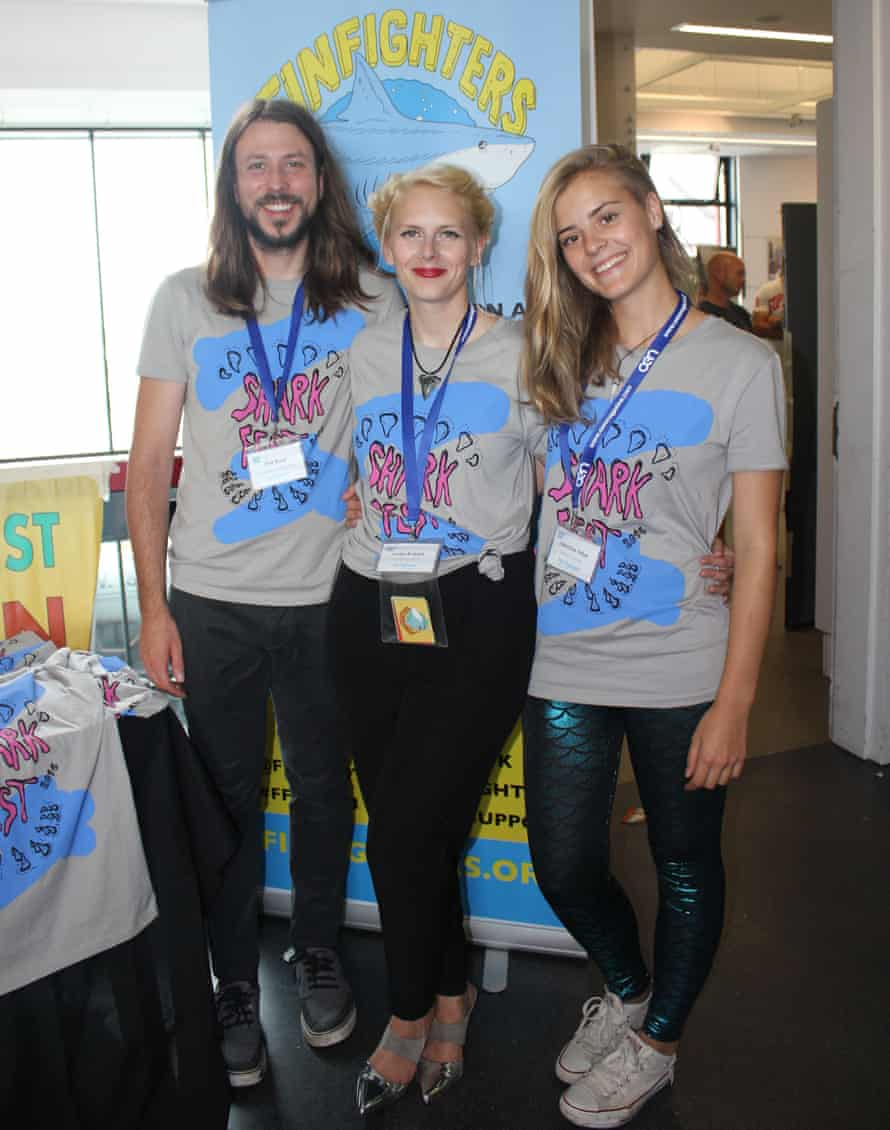 Fin Fighters co-founders Phil Root and Lou Ruddell (centre) with SharkFest event manager Jasmine Tribe.