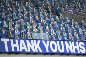 Cut-outs of fans in the stands before the match.