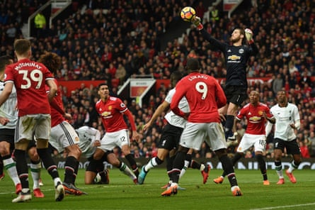 David de Gea rises to punch the ball clear.
